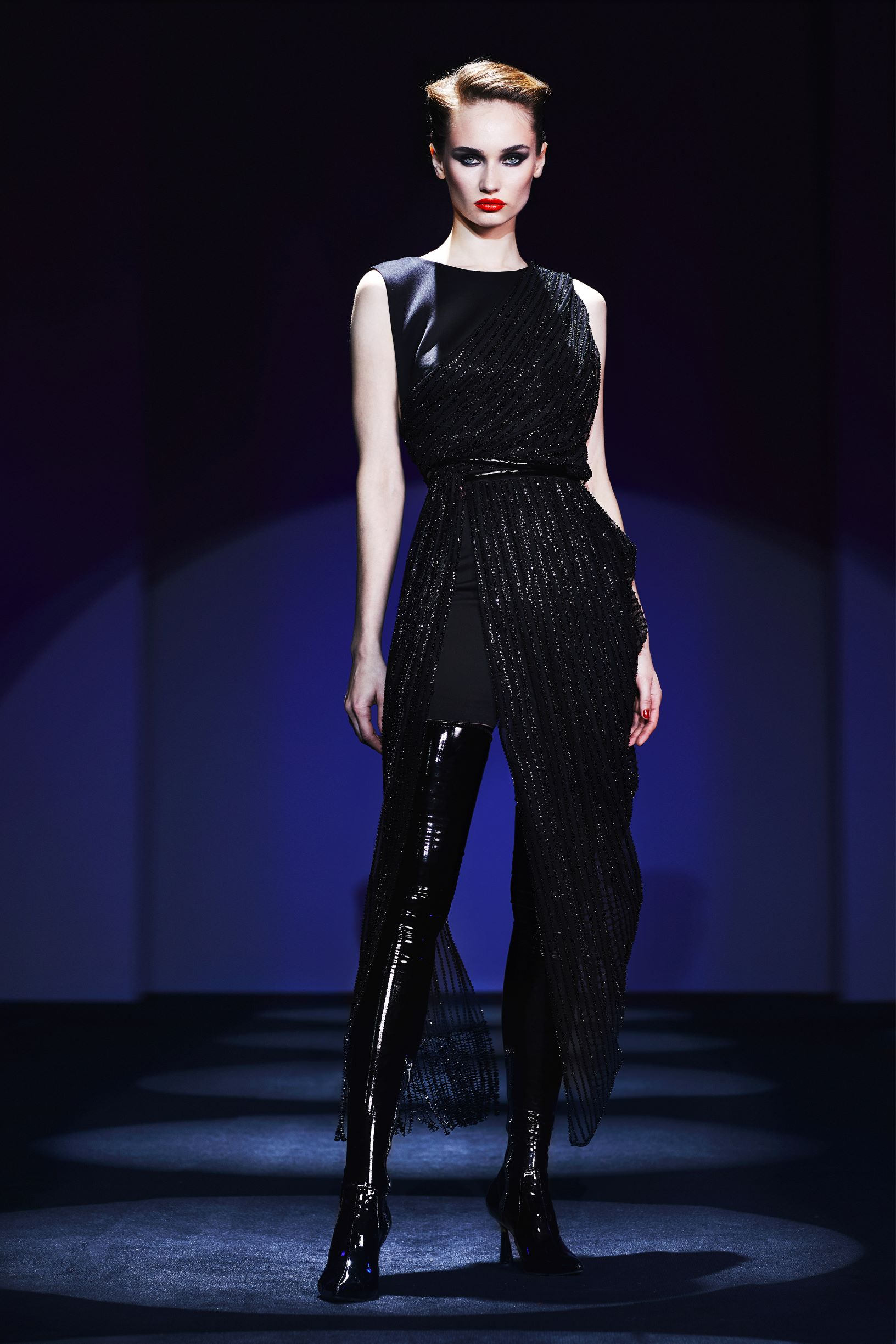 Asymetrical beaded draped  dress with transparent  detail and leather belt