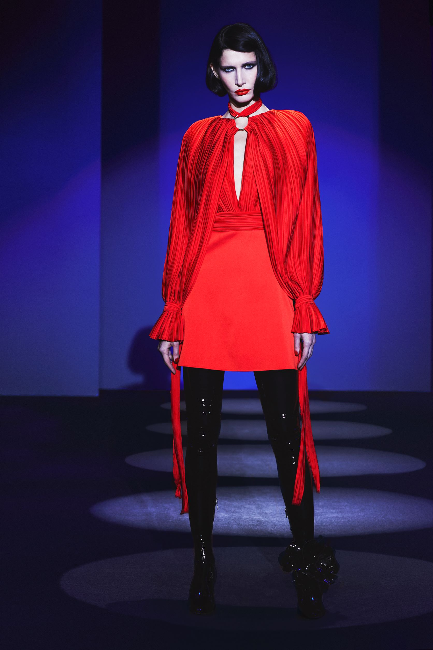 Pleated mini dress with cape sleeves with knotted on wrists and circle on collars